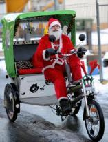 Santa Claus on a rikscha